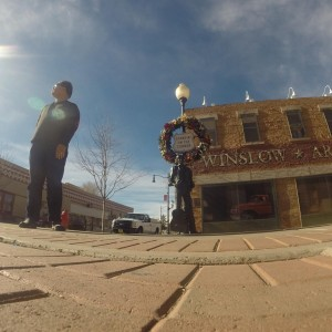 EZPZ's Head Game Coach standing on a corner in Winslow, AZ.